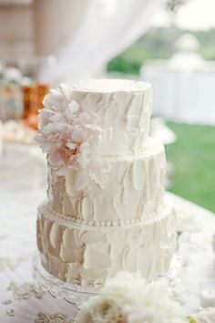 Three Tier Textured Wedding Cake With Pink Flowers
