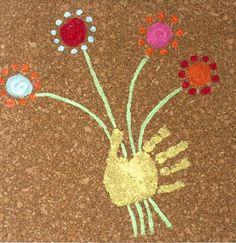 Make a Mother's Day gift that's both pretty and practical! Handprint Art Cork Board