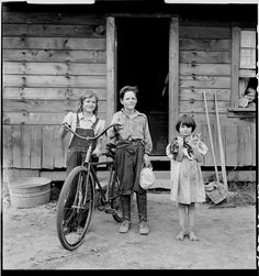 Three of the four Arnold children. The oldest boy earned the money to buy his bicycle. Western Washington, Thurston County, Michigan Hill. 1939 Aug. Library of Congress.