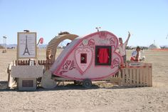 heart shaped pink teardrop trailer at Burning Man
