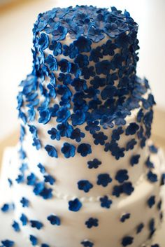 pretty wedding cake of blue cascading blossoms, are the blossoms made of sugar? if they are I am in trouble