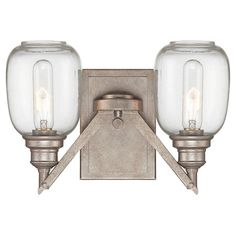 Wall sconce with an industrial steel finish and glass shades.  Product: Wall sconceConstruction Material: Metal ...