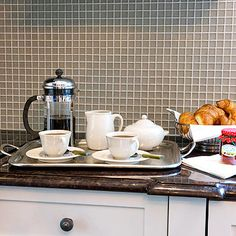 Clear off your countertops as much as possible—holiday preparations and hosting are much easier with a clear work surface. In the mornings, keep a tray on the counter with a basic coffee or tea service items so guests can help themselves. At lunch and dinner, fill the tray with condiments and seasonings.