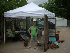 Old screens and doors on tent, by Texas Trash and Treasures