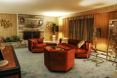 Roz House Family Room 1: Set of Roz's (played by Jennifer Lawrence) house.  The vintage ranch house had to be completely redone, except for the stone fireplace.  Every inch of the house was covered in vintage foil patterned wallpaper, carpeted, furnished and switched out with vintage appliances as seen in Columbia Pictures' AMERICAN HUSTLE.  Production Design by Judy Becker Photo by:  Alex Linde
