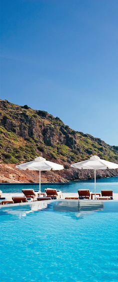A sleek family-friendly resort with spacious rooms and show-stopping views of the Mediterranean. #Greece