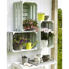 For the deck. Painted crates hung on the wall.