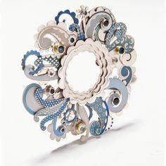 Brooch   Barbara Macleod. 'Swirl'.  Sterling silver, enamel, sapphire, aquamarine, topaz and 18k gold.