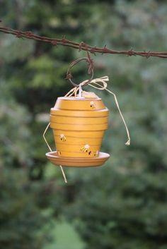 Repurposed Clay Pot Birdfeeder by PleasantNookRanch on Etsy, $25.00