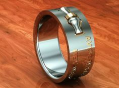 A duck band ring w/ your names and the date you got married so he doesn't forget. hah Rachel??