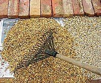 How to Make A Gravel Patio -- Done, maybe use some sort of bonding agent to create a hard area for the patio set!