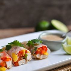 Mango and red pepper chicken spring rolls with a Thai inspired peanut sauce. Appetizer or dinner worthy for sure.