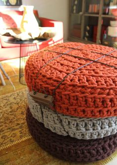 tires (?)...crocheted covers...bound together...become ottoman...super clever