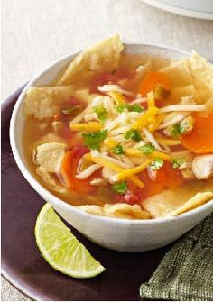 Slow-Cooker Chicken Tortilla -- Cheese tops bowls of chicken tortilla soup that literally cooks itself in a slow-cooker. Enjoy your time away from the stove after just 15 minutes of prep!