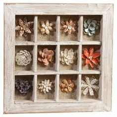 Add a touch of country charm to your decor with this warmly weathered shadowbox, showcasing an array of multicolor shell and ceramic flowers. - I have a box that I could use this way.  Maybe there's room in the play room?
