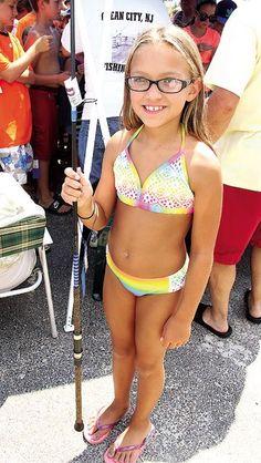 Bridget Hazewski, 8, of Avondale, Pa. wins the raffle drawing for an 8-inch KM Custom Rod by Mike Kulick.