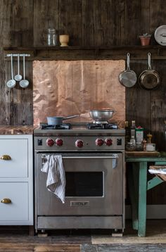 rustic kitchen with copper backsplash