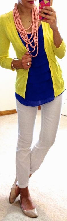 White jeans, blue top, yellow cardigan