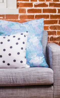Tiger Fish Blue by Aimee St. Hill Throw Pillow mixes with Vintage Black Dots by Garima Dhawan Throw Pillow!
