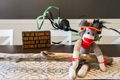 Watch out Sock Monkey! Warn your visitors about what might be lurking around the corner with fun Halloween décor from Cracker Barrel.