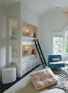 built-in bunks with a library ladder