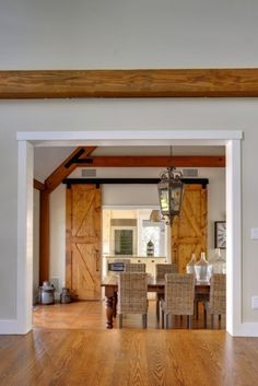 Great room to dining room to kitchen - Yankee Barn Homes