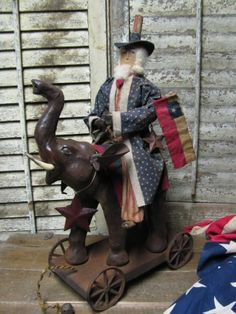 4th Of July Parade Sam! Direct from Folk  Artist Sue Corlett.  New items every Sunday. Follow me in Facebook for update details,