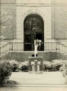 Athena yearbook, 1987. Students walk into Chubb Hall from the College Green entrance. :: Ohio University Archives