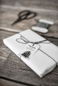 White wrapping with black and white twine.