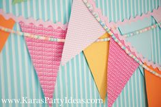 Candyland birthday party pennant banner made out of scrapbook paper and candy necklaces! #candyland #birthday #party #ideas #candy #necklace #pennant #banner