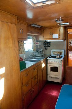 Trailer kitchen. Love the tiny stove.