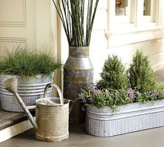 galvanized planters and watering can