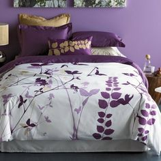 Look at the pretty purple bedroom!