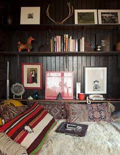 Shelves mounted on batten-board siding