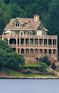 Multi-story wood & stone lake house