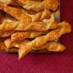 Fast holiday party appetizers, like these sesame cheddar twists, will save you some stress when planning a holiday party!