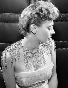 The salon of Christian Dior designed this necklace that showers rhinestones over shoulders, back and chest, 1950