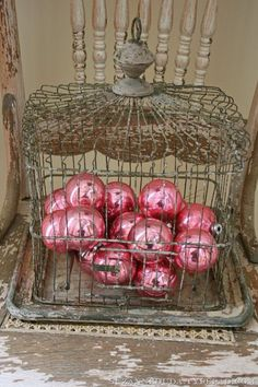 Shabby chic christmas bird cage with pink ornaments