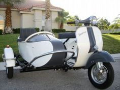 Vespa with sidecar. Wonder if it has Grommet's airplane conversion feature.