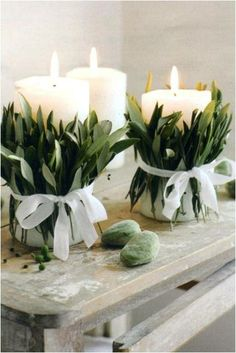 White candles wrapped in herbs will radiate a soft glow as well as fresh aromas.