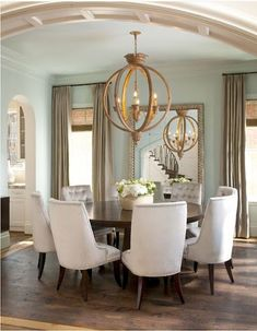 love the round dining table & the chairs