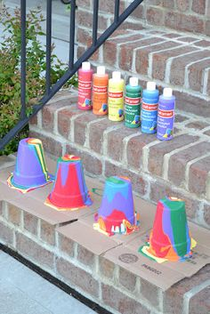 Rainbow Pour Painting on Flower Pots - In Lieu of Preschool