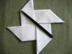 Folding a napkin into a pinwheel shape (ninja stars?)