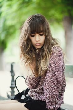 Fashion blogger Rumi Neely's pairing of blunt bangs and ombre highlighted tips creates the ultimate contrast.