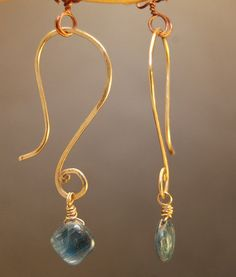 Nouveau 25 Curved hammered ear wires with your choice of A-grade stone. $46.00, via Etsy.