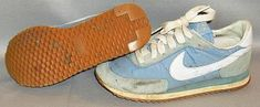 A pair of well-used early 1980s Nike powder blue sneakers/trainers