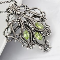 Pendant | Sarah Thompson. Fine and sterling silver, marquise Peridots.
