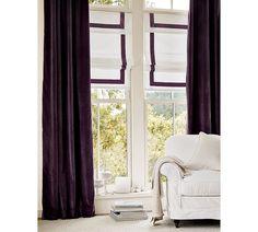 Ribbon-trimmed roman shades & velvet curtains