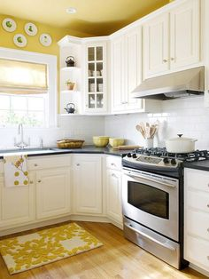 yellow kitchen, kitchen colors, corner cabinets, yellow walls, subway tiles, painted ceilings, white cabinets, white kitchens, kitchen cabinets