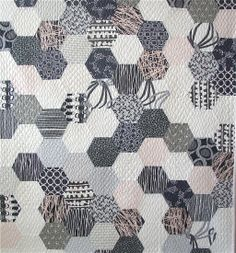 All hexagons all the time by Jacquie Gering.  Grays with a hint of pink.